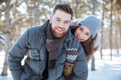 Beautiful couple standing in winter park Stock Photo