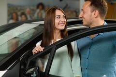 Beautiful couple stay behinde the car door. royalty free stock photography