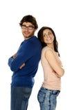 Beautiful couple stood back to back isolated on a white backgrou Royalty Free Stock Photos