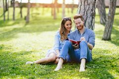 Beautiful couple studying together for exams royalty free stock photos