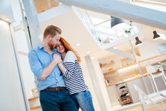 Beautiful couple in stylish home Stock Images