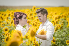 Beautiful couple in a sunflower field Royalty Free Stock Image