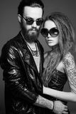 Beautiful couple in sunglasses and leather Stock Images