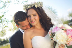 Beautiful couple in the sunlight. Lovely day wedding Stock Images