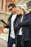 Beautiful couple with tablet in the city Royalty Free Stock Photo