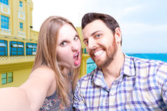 Beautiful Couple taking a selfie photo in Bahia, Brazil Royalty Free Stock Photography