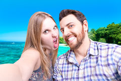 Beautiful Couple taking a selfie photo on the beach Stock Photography
