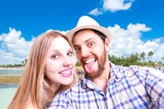 Beautiful Couple taking a selfie photo in the beach Royalty Free Stock Photos