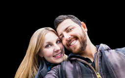 Beautiful Couple taking a selfie photo on black background Stock Images
