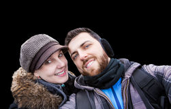 Beautiful Couple taking a selfie photo on black background Royalty Free Stock Photo