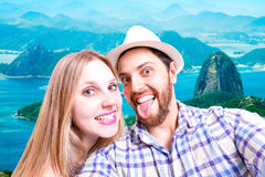Beautiful Couple taking a selfie photo in Rio de Janeiro, Brazil Royalty Free Stock Images