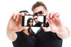 Beautiful couple taking a selfie with smartphone Stock Image