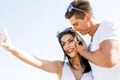 Beautiful couple taking a selfie of themselves on a beach Stock Photography