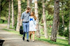 Beautiful couple taking a walk in nature royalty free stock photography