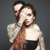 Beautiful couple with tattoo. love Stock Photos
