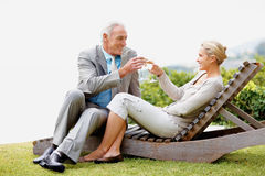 Beautiful couple toasting wine glasses outdoors Stock Images