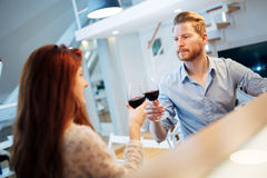 Beautiful couple toasting with wine Royalty Free Stock Image