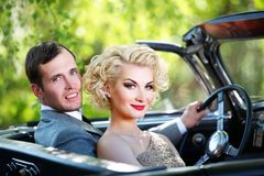 Beautiful couple together in a car Stock Photos