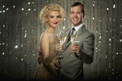 Beautiful couple together celebrating Royalty Free Stock Photos