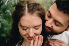 Beautiful couple touching and flirting each other stock images