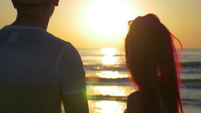 Beautiful couple touching and kissing at twilight on the shore. Beautiful couple touching and kissing at twilight stock video
