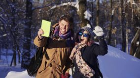 Beautiful couple of tourist in winter sunny day stock footage
