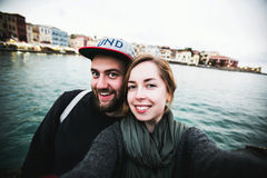 Beautiful couple of tourists take travel selfie Stock Image