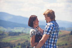 Beautiful couple of travelers in love. Happy beautiful couple of travelers in love stock images