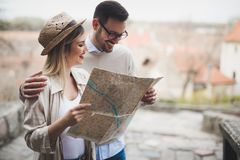 Beautiful couple traveling and sightseeing. Beautiful tourist couple in love traveling and sightseeing Stock Images