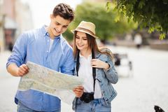 Beautiful couple traveling and sightseeing in new city. Beautiful couple traveling and sightseeing on streets royalty free stock photography