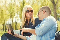 Beautiful couple using a digital tablet Royalty Free Stock Photos