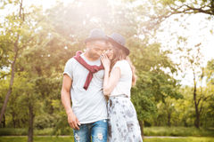 Beautiful couple waking in summer park Stock Images