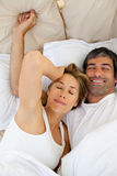Beautiful couple waking up. Lying in bed Stock Photography