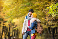 Beautiful couple on a walk in autumn forest Royalty Free Stock Images