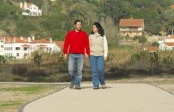 Beautiful couple walking Stock Images