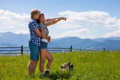Beautiful couple walking together at the summer meadow. And looking around countryside view stock images