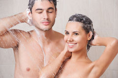 Beautiful couple washing in the shower. Young beautiful couple washing in the shower Stock Image