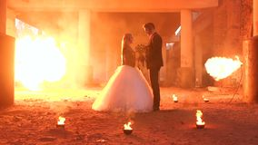 Beautiful couple in wedding attire with a terrible makeup for Halloween.Hellfire. Beautiful couple in wedding attire with a terrible makeup for Halloween are stock video