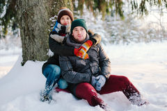 Beautiful couple in winter forest Royalty Free Stock Photography