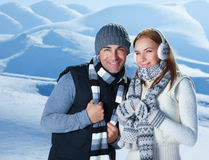Beautiful couple in winter mountains Royalty Free Stock Photo