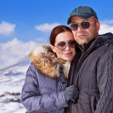 Beautiful couple on winter vacation Stock Images