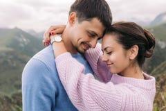 Beautiful couple woman and man hugging stock image