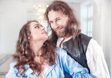 Beautiful couple woman and man in medieval clothes. Beautiful passionate couple women and men in medieval clothes Stock Image