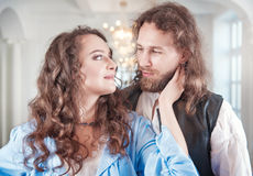 Beautiful couple woman and man in medieval clothes. Beautiful passionate couple women and men in medieval clothes Stock Images