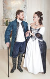 Beautiful couple woman and man in medieval clothes. Beautiful couple women and men in medieval clothes in the room Royalty Free Stock Photos