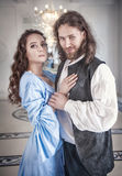 Beautiful couple woman and man in medieval clothes. Beautiful couple women and men in medieval clothes in the room Stock Photo