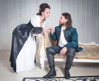 Beautiful couple woman and man in medieval clothes Royalty Free Stock Image