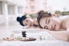Beautiful couple woman relaxing massage treatment at beauty spa. Stock Image