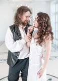 Beautiful couple woman and man in medieval clothes. Beautiful couple women and men in medieval clothes in the room Stock Photos
