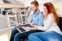 Beautiful couple working on laptop Royalty Free Stock Image